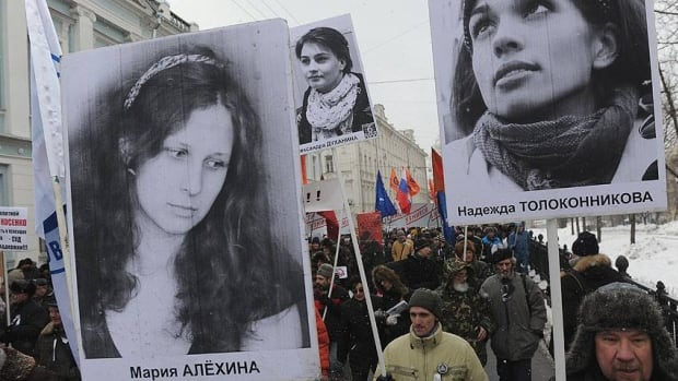 Anti-government activists protesting in Moscow in March demanded the release political prisoners while brandishing the portraits of jailed Pussy Riot members Maria Alekhina, left, and Nadezhda Tolokonnikova.