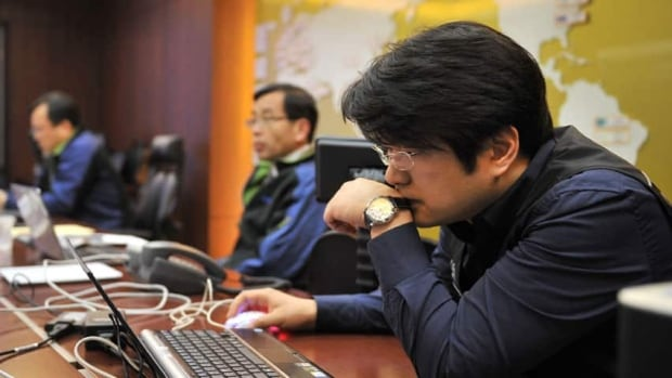 Members of the Korea Internet Security Agency check on cyberattacks at a briefing room of in Seoul on March 20.