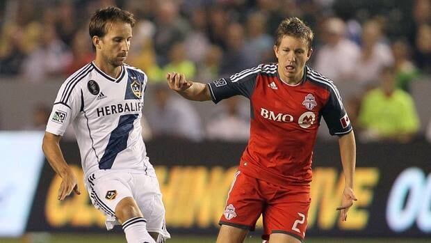 Terry Dunfield of Toronto FC, right, pressures the pass play of Mike Magee of the Los Angeles Galaxy on September 22, 2012 in Carson, California.