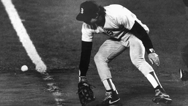 In this Oct. 25, 1986 file photo, Red Sox first baseman Bill Buckner misplays the ball during Game 6 of the World Series against the New York Mets.