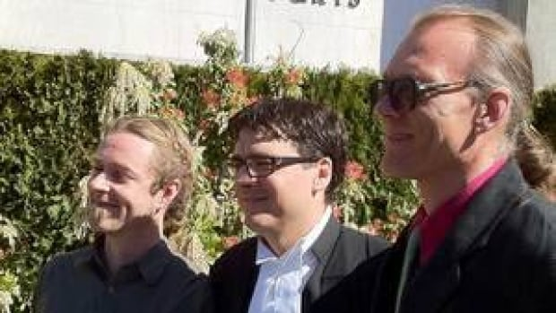Ted Smith, president of Cannabis Buyers' Club of Canada, right, stands outside the B.C. Supreme Court courthouse in Victoria, with Owen Smith, left, and lawyer Kirk Tousaw following a recent legal victory.