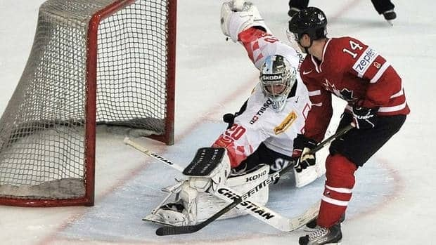 Canada's Jordan Eberle beats Switzerland's goalkeeper Reto Berra for the shootout winner in a 2-1 exhibition victory on Sunday. It was the first of two warmups for the world championship.