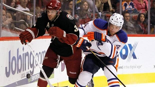 Phoenix Coyotes defenceman Keith Yandle and Edmonton Oilers forward Taylor Hall battle during a game in Glendale last season.