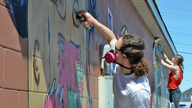 A group of artists, including local professional graffiti artists, paintbombed the Mac's at 745 Simpson St. in Thunder Bay. The large-scale professional contemporary wall art painting was designed and executed by more than a dozen youth involved in the Die Active group, following mentorship workshops and training at Definitely Superior Art Gallery.