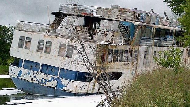 The MS Lord Selkirk II sits in the Selkirk slough shortly after a fire in June 2012.