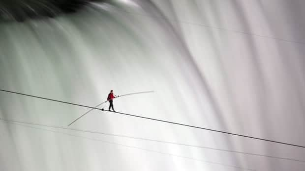 Nik Wallenda walks over Niagara Falls on a tightrope in June. He calls his dispute with the city on the American side disheartening.