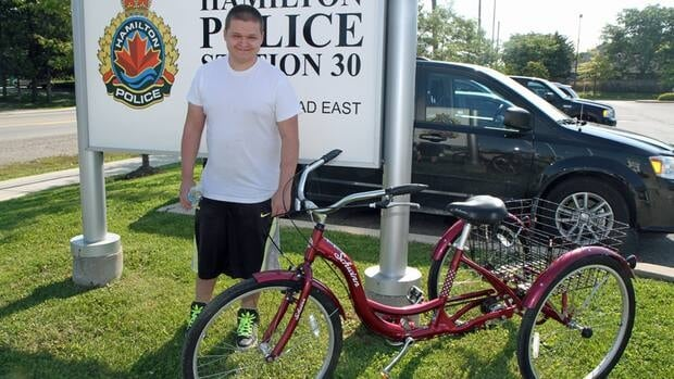 Justin Connors, 22, picks up his Schwinn Meridian adult tricycle from the the Hamilton police's Division 30 headquarters. It was stolen from the backyard of his family's central Mountain home on Sunday night.