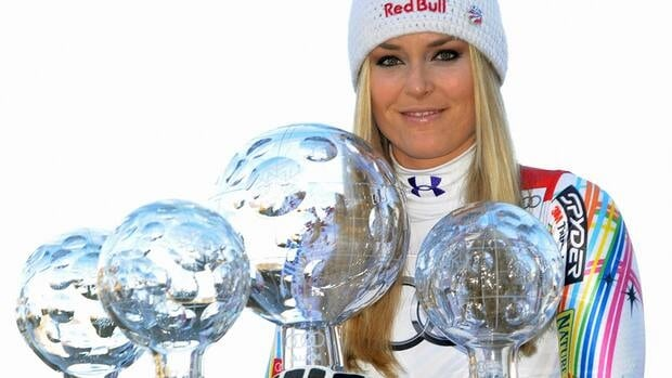 American alpine skier Lindsey Vonn poses with her World Cup trophies in Schladming, Austria in March.