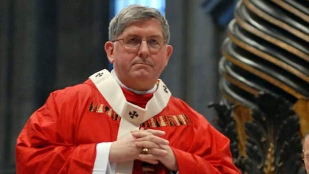 Cardinal Thomas Collins, seen here during a Vatican ceremony in 2007, is calling on the federal government to protect the vulnerable and those who care for them.