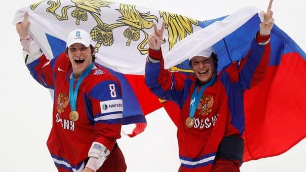 Russia's Alexander Ovechkin, left, and teammate Alexander Syomin are seen celebrating the 2012 world championship title.