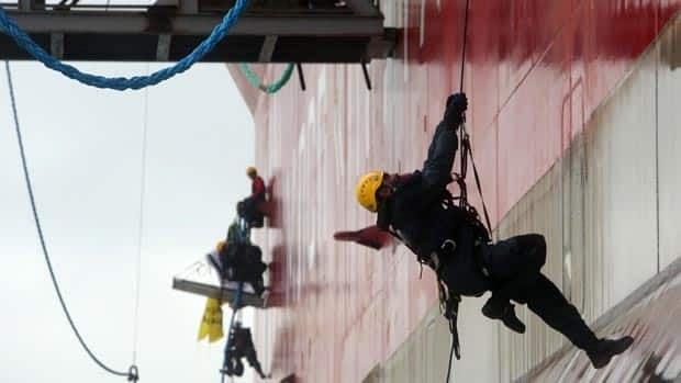 Greenpeace activists board the Prirazlomnaya off the northeastern coast of Russia in the Pechora Sea