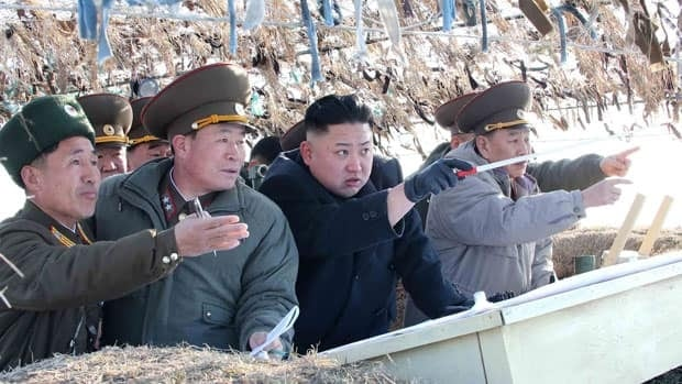 North Korean leader Kim Jong-un, centre, visits a defence detachment near Baengnyeong Island of South Korea on Monday.