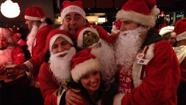 About 70 people in Winnipeg dressed up in Santa Claus suits to raise money for the Christmas Cheer Board.