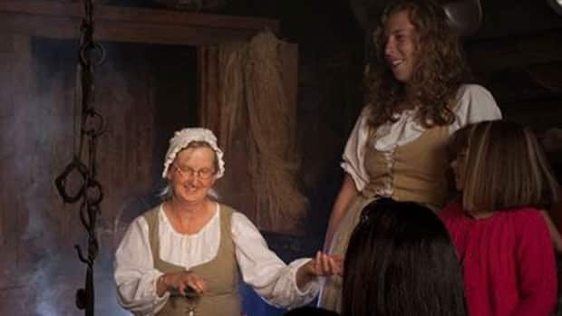 Animators at the Highland Village Museum in Cape Breton entertain guests.
