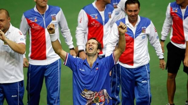 Czech Republic's Radek Stepanek, centre, celebrates with other members of his team after winning his Davis Cup finals match against Spain's Nicolas Almagro in Prague, Czech Republic, on Sunday.