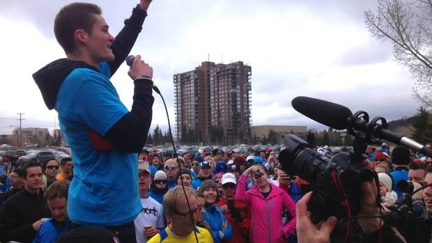 Run for Boston organizer Trevor Hofbauer speaks to the hundreds of runners gathered Saturday at Edworthy Park.