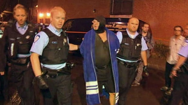 Richard Henry Bain was arrested at the scene of Quebec's election-night shooting shortly after the stage door of Montreal's Metropolis concert hall was set on fire.
