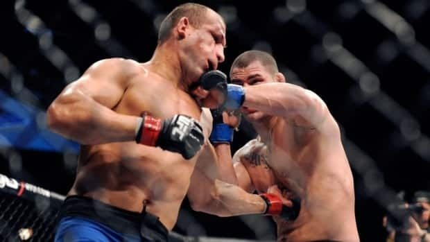 Junior Dos Santos, left, and Cain Velasquez connect with each other during their UFC 155 heavyweight championship match at the MGM Grand Garden Arena in Las Vegas on Saturday night.
