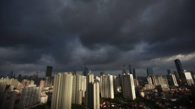 Dark clouds cover the sky in downtown Shanghai on Monday. Heavy rains will hit many areas in south and east China from Sunday to Tuesday, as Typhoon Haikui is moving northwestward from Okinawa, Japan, to affect China's coastal region.