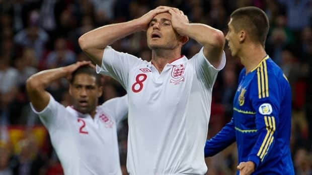 England's Frank Lampard, centre, and Glen Johnson, left, react after missing a chance to score against Ukraine during their Group H qualifier at Wembley on Tuesday.