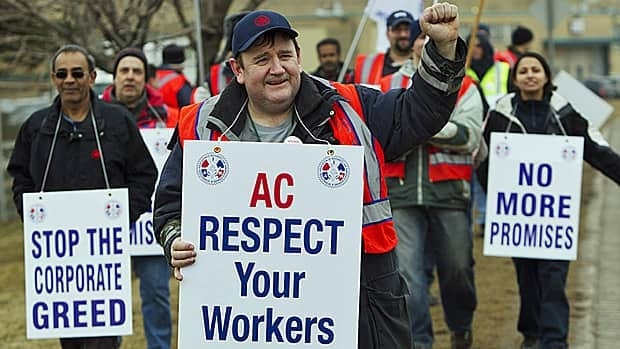 Air Canada mechanics, baggage handlers and cargo agents protested the carrier's contract offer at Toronto's Pearson airport on Monday.