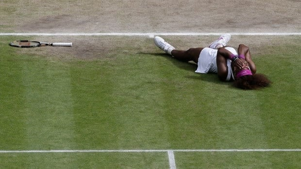 Serena Williams of the United States reacts after defeating Agnieszka Radwanska of Poland to win the women's final match at the All England Lawn Tennis Championships at Wimbledon, England, Saturday.