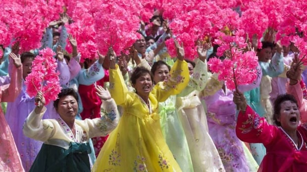 North Korean women wave to their leader Kim Jong-un during a mass military parade in Pyongyang in July, 2013. South Korea on Monday proposed that the rival Koreas restart arranging reunions next month for families separated by the 1950-53 Korean War.