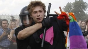 Russian police detain a gay rights activist in St. Petersburg on June 29, 2013. The RCMP plans to brief Canada's Olympic team on Russia's anti-gay laws ahead of the Olympics in Sochi.