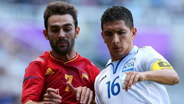 Johnny Leveron, right, is seen battling for Honduras against Spain in a 2012 match.