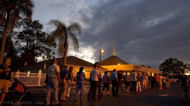 Long lines of voters wait to cast their ballots at a Fort Myers, Fla., church late on Tuesday. Florida was among some states that had long lineups to cast ballots, but the Sunshine State's waits approached marathon levels.