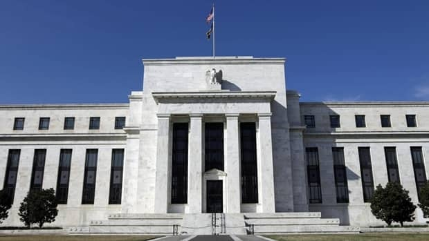The Federal Reserve building in Washington. The Fed said Wednesday that it will continue its stimulus measures in an attempt to boost employment.