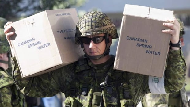 A Canadian soldier carries supplies as troops arrive at a temporary medical centre in Port-au-Prince, Haiti, in January 2010. A handful of Canadian troops are about to take part in peacekeeping operation in Haiti under the command of Brazilian forces.