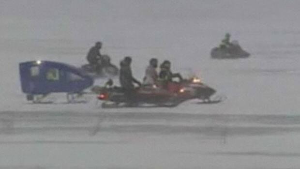 Searchers head across Lake Winnipeg to look for Al Hadley on Wednesday.