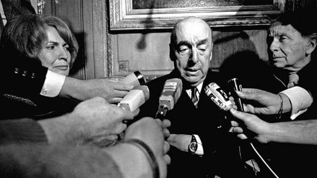 In this Oct. 21, 1971 file photo, Pablo Neruda, poet and then Chilean ambassador to France, talks with reporters in Paris after being awarded the 1971 Nobel Prize for Literature.