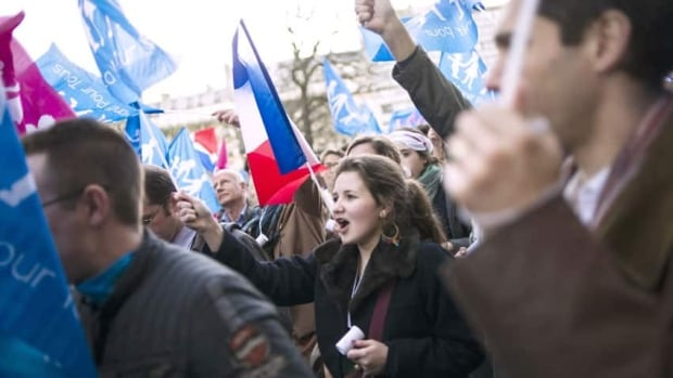 Protesters opposed to same-sex marriage demonstrated in Paris today. France's Senate voted to approve a landmark bill granting gay couples the right to marry and adopt, after a heated debate and mass protests from conservatives and religious groups. The bill could become law by summer.