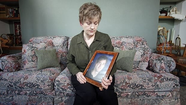 Karen Williams holds up a photo of her deceased son, Loren, in Beaverton, Ore. Her cause to challenge Facebook for full access to her son's account is backed by the Oregon Legislature, only to be turned back by pressure from the tech industry.