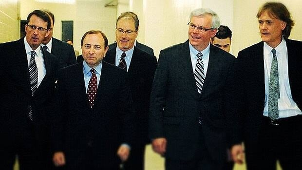 Winnipeg Jets chairman Mark Chipman, NHL Commissioner Gary Bettman, Manitoba Premier Greg Selinger and Jets co-owner David Thomson walk through the MTS Centre prior to announcing the NHL's return to the city on May 31, 2011.