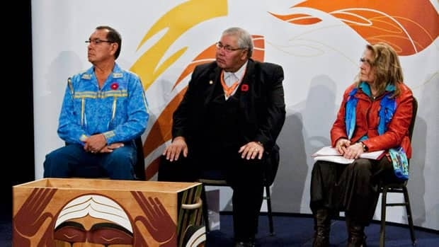 Commissioners Chief Wilton Littlechild, Justice Murray Sinclair and Marie Wilson, left to right, listen to testimonials as the Truth and Reconciliation Commission holds its third round of national hearings in Halifax on Oct. 29, 2011.