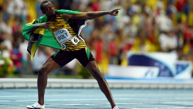 Usain Bolt of Jamaica celebrates winning gold in the Men's 100 metres Final during Day Two of the 14th IAAF World Athletics Championships Moscow 2013 at Luzhniki Stadium on Sunday in Moscow, Russia.