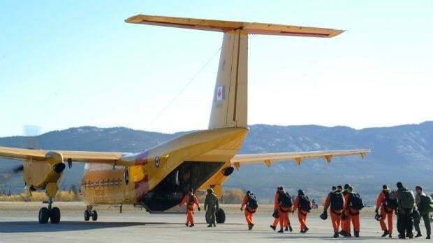 Canadian Forces search and rescue technicians board a C-115 Buffalo before participating in a search and rescue exercise in Whitehorse in September 2010.