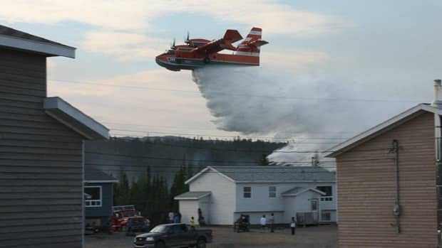 A water bomber making a drop near Natuashish on Sunday.