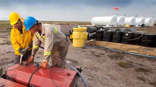 Two local men work at the fuel storage site at the proposed Kiggavik uranium mine, near Baker Lake, Nunavut.