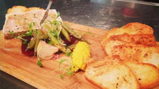 Smoked chicken terrine with homemade condiments.