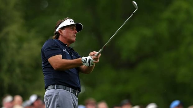 Phil Mickelson hits his tee shot on the sixth hole during the second round of the Wells Fargo Championship at Quail Hollow Club on Friday in Charlotte, N.C.