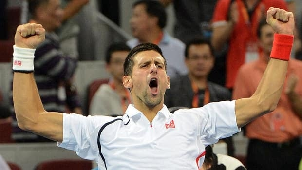 Novak Djokovic of Serbia celebrates after winning the men's singles final against Jo-Wilfried Tsonga of France at the China Open tennis tournament by scores of 7-6, 6-2.