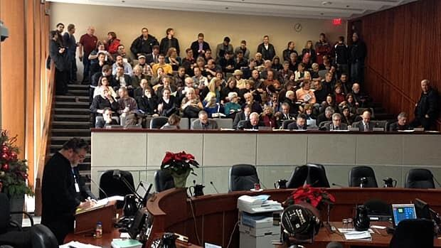 Landlords, realtors and other interested citizens packed the gallery at a city planning committee meeting Tuesday afternoon. Most were against a proposed bylaw that would license units in buildings with six or fewer apartments. (Samantha Craggs/CBC)