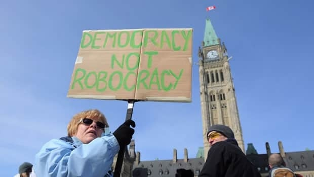 A small crowd gathered on Parliament Hill Monday to call for a public inquiry into the election call controversy.