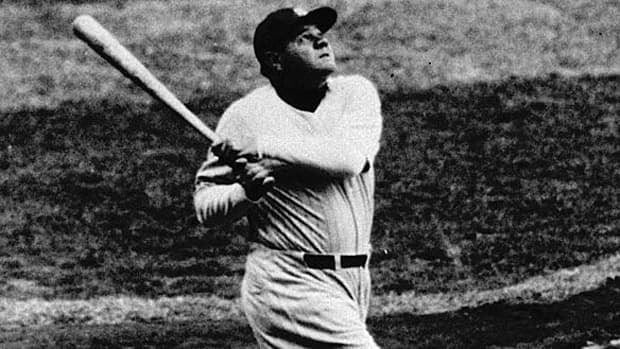 Babe Ruth launches one of his 714 home runs in this archival AP photograph.