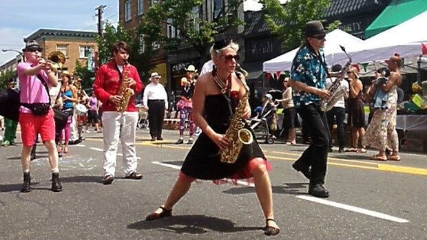 Vancouverites celebrate car-free day on Commercial Drive.