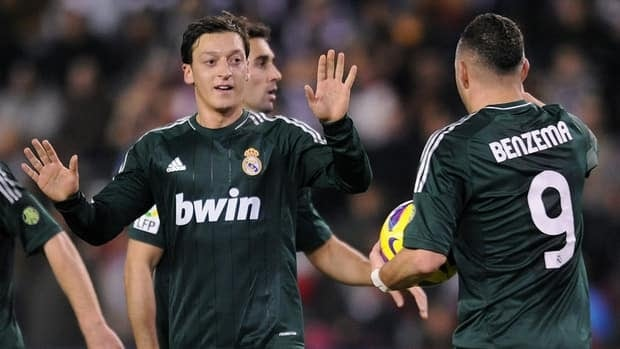 Mesut Ozil of Real Madrid, left, celebrates after scoring his side's second goal against Real Valladolid on Dec. 8, 2012 in Valladolid, Spain.